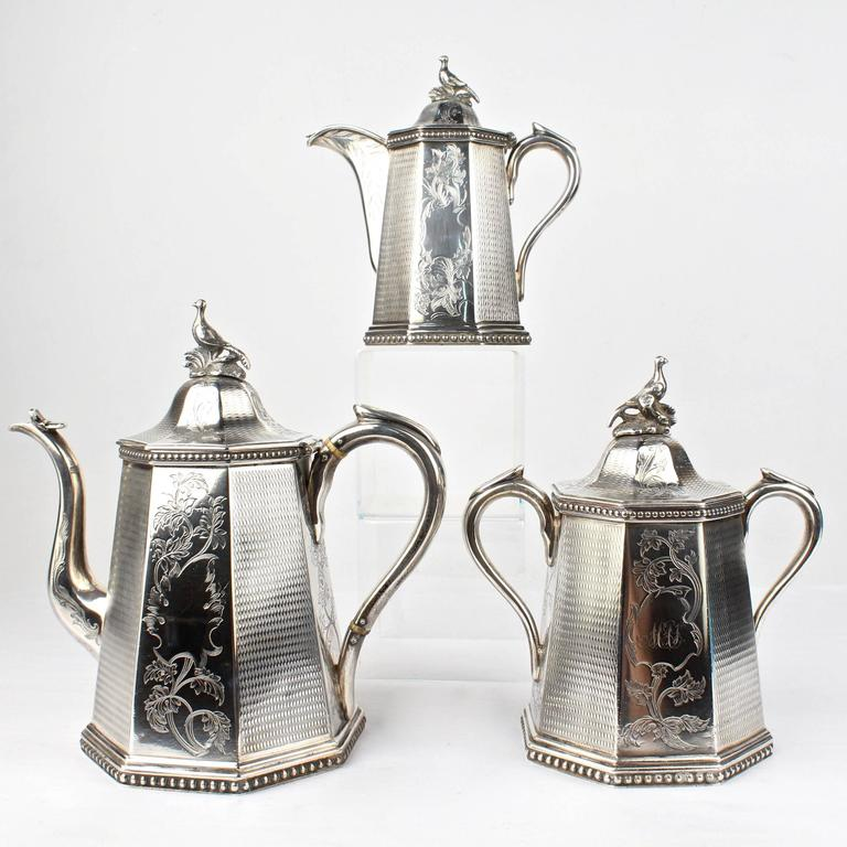 A heavy, three-piece, 19th century American coin silver tea set by the renowned New York silversmiths, Wood & Hughes.