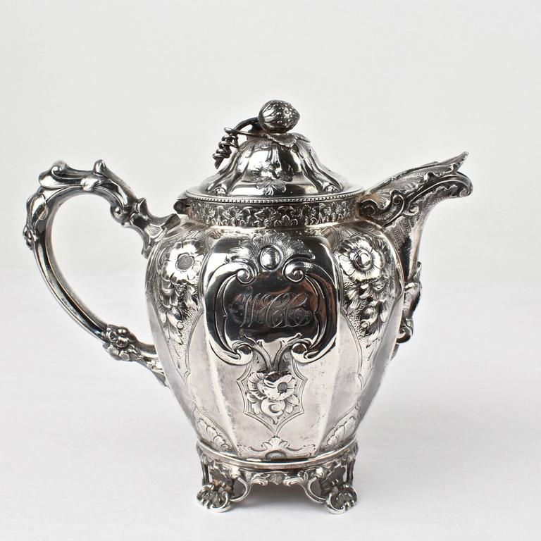 Victorian 19th Century Four-Piece Wood and Hughes Repousse New York Coin Silver Tea Set For Sale