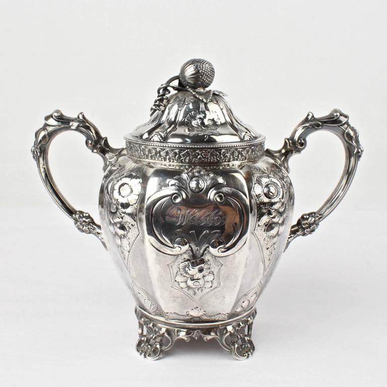 American 19th Century Four-Piece Wood and Hughes Repousse New York Coin Silver Tea Set For Sale