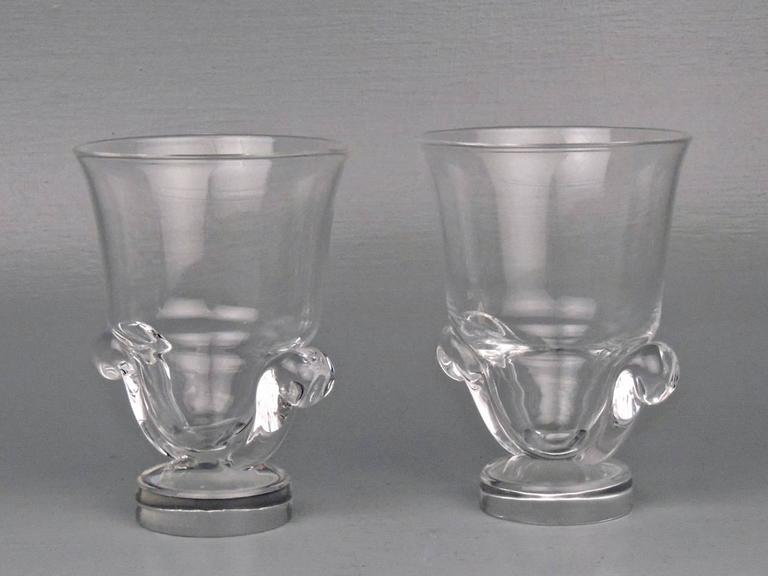 A good pair of Steuben vases with scroll handle and disc feet.  Designed by George Thompson in 1948.  Marked Steuben to bases.  Height: ca. 6 in.   Items purchased from David Sterner Antiques must delight you. Purchases may be returned for