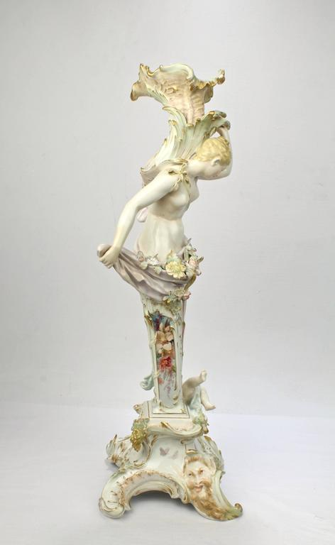 An extremely rare, figural KPM porcelain candlestick or candelabrum base with Weichmalerei decoration. 