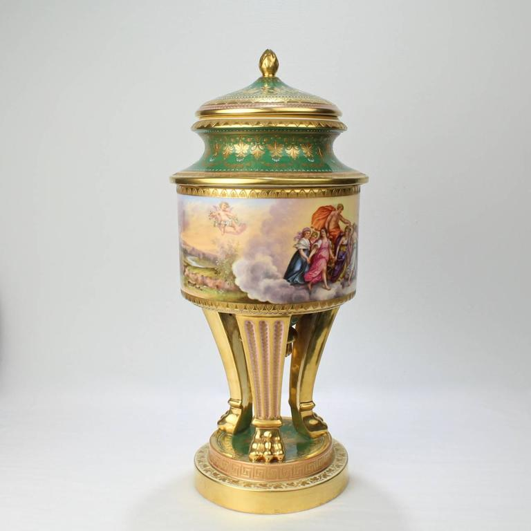 A large, heavily gilt Royal Vienna porcelain covered urn of exceptional quality. 