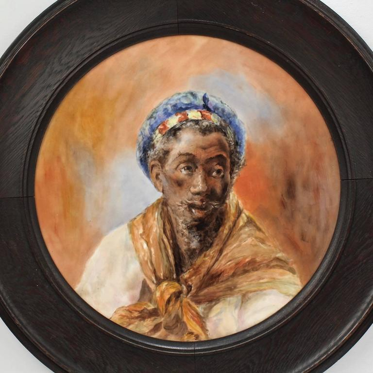 A fantastic, large-scale antique Orientalist hand-painted Limoges wall plaque.  Depicting a North African sitter in three quarter profile much in the style of Jean Joseph Benjamin-Constant's 'Head of a Moor' or the many Spanish Moor paintings by