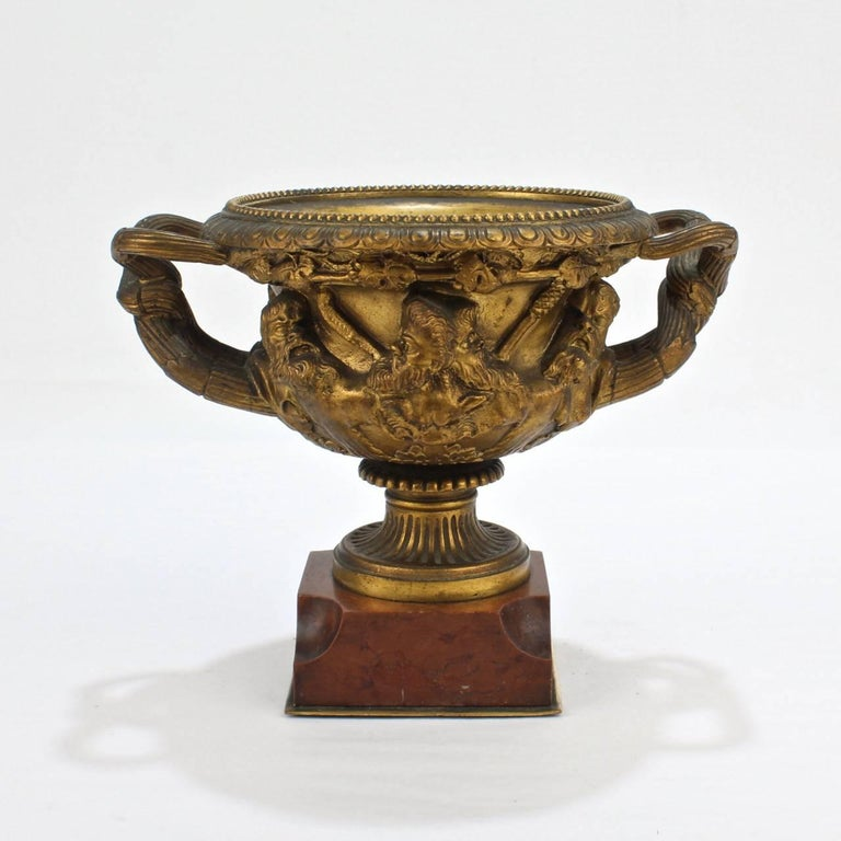 A diminutive, cabinet size gilt bronze Warwick vase.