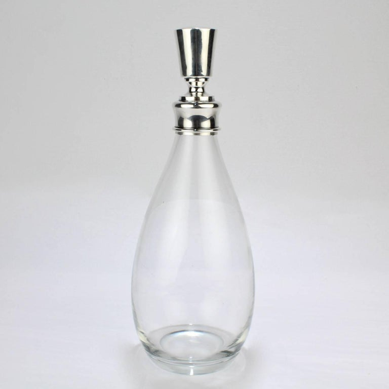 A fine, modernist Hawkes glass and sterling silver mounted decanter or bar bottle.