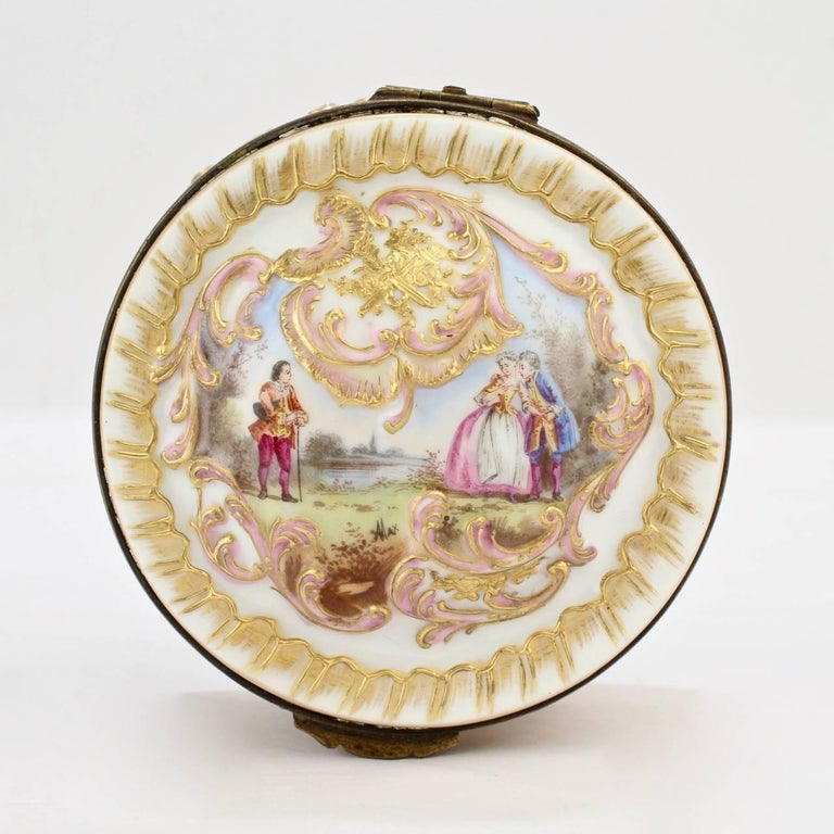 A compelling round 19th century Paris porcelain box by Bloch and Bourdois.