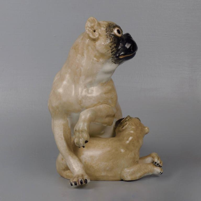 A rare, early 19th century English hard-paste porcelain pug & puppy figurine. These early English figurines are all modeled after the Meissen factory's first Pug model by J. Kaendler (in an attempt to reproduce his fashionable style that had taken