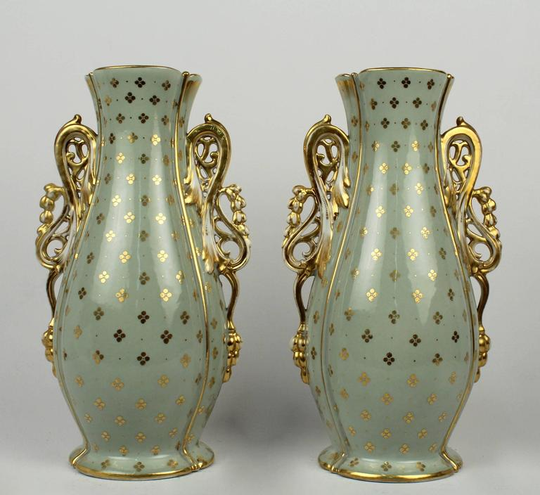 A Fine pair of 19th Century Old Paris porcelain vases.   With central cartouches depict a hand-painted scenes with seated young maidens.   Extensive gilding to the pale green ground.  Height: circa 13 1/4 in.  Items purchased from David Sterner