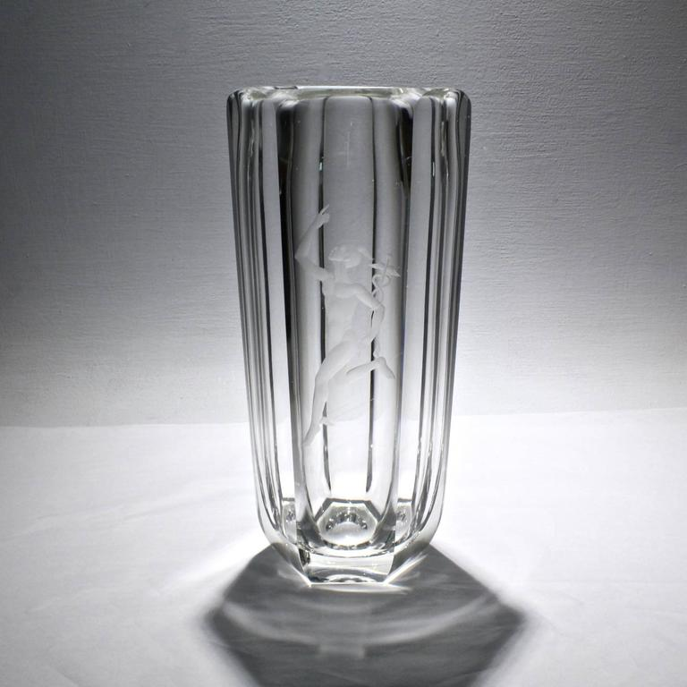 A fantastic, large, faceted Art Deco vase by Elis Bergh for Kosta Boda with an engraved image of the Greek god Mercury in full stride on the front. 