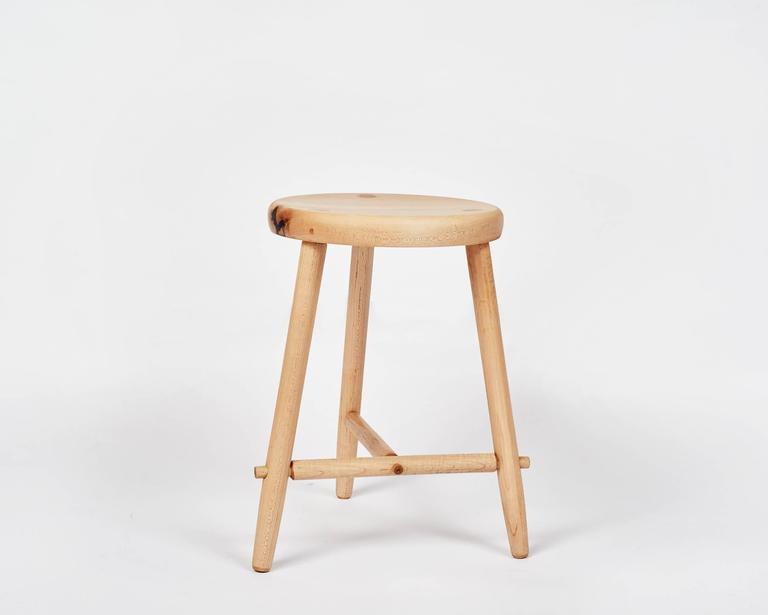 A single tripod stool in maple.