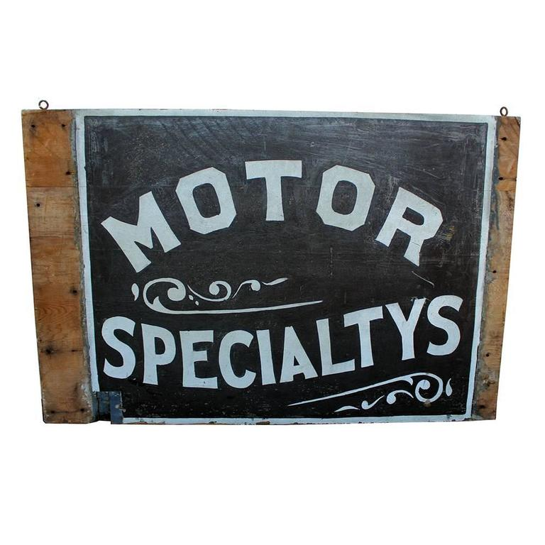 An excellent example of early 20th century advertising. This sign, circa 1910 was hand-painted in reflective sand paint on wood board with stylized text and decorative flourishes.