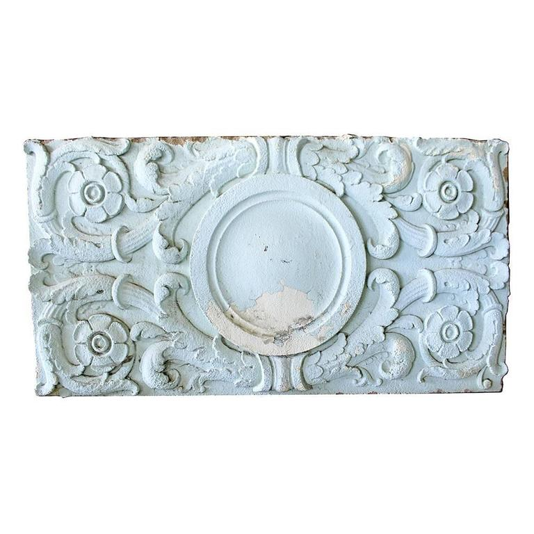 A set of massive cast stone architectural panels that exemplify the beauty of early 20th century architecture. Salvaged from the Lone Oak Race Track in Salem or these panels feature a central cartouche that is surrounded by swirling floriated