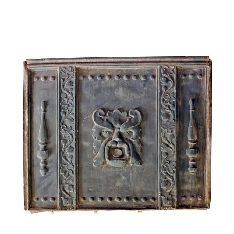 """These monumental architectural relief panels are made from a zinc alloy. The central figure represents the """"Green Man"""", an ancient myth celebrating the mystery rebirth of flora and nature. Salvaged from a late 19th-century building in the mid-west,"""