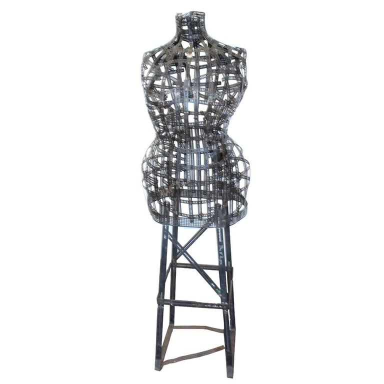 "In the city dubbed ""the Paris of the West"", a woman named Natalie Schell patented this adjustable bust dress form from strips of malleable metal. A highly unusual article in itself, the fact it was the creation of a female inventor makes it all"