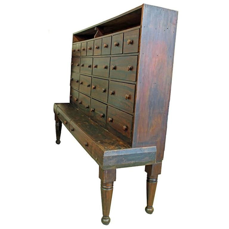 An absolutely exceptional piece of early American furniture. This circa 1850 cabinet is generously sized and has 22 drawers overall. The hand-stenciled drawer fronts are labeled for dry goods, spices, and other sundry items including an obscure