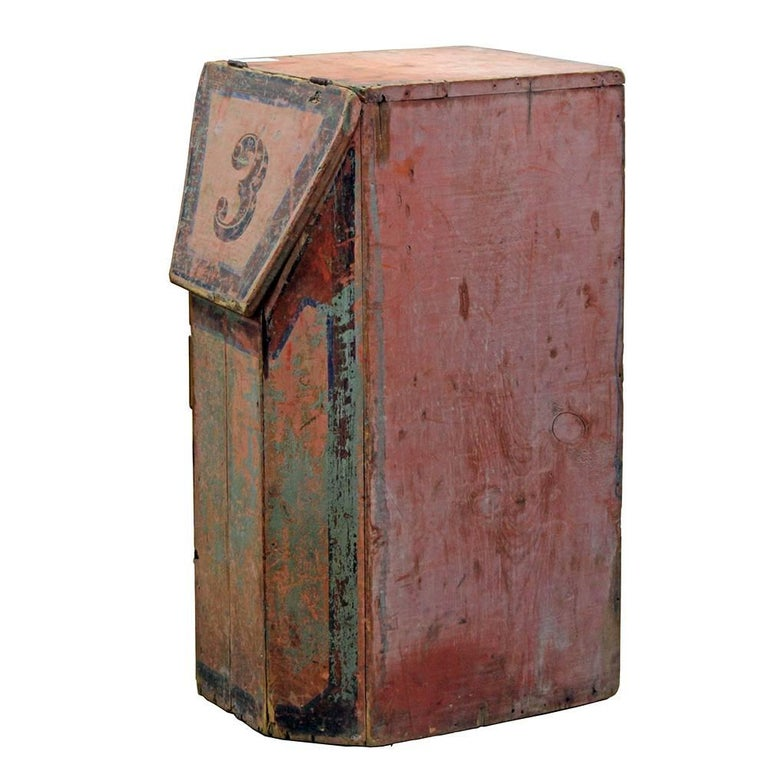 Salvaged from a building in New York that had been a coffee roasting facility in the early 20th century, this hand-painted bin has a beautiful Primitive/folk aesthetic. The four-panel beveled front complements the hinged lid, painted with the number