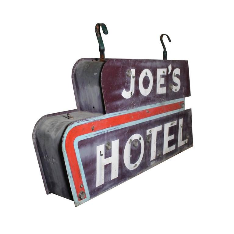 """Salvaged from upstate New York, this sign looks as though it could have sprung from the canvas of an Edward Hopper painting. This hand-painted """"can-light"""" style sign has terrific late Deco era styling in its font and design."""