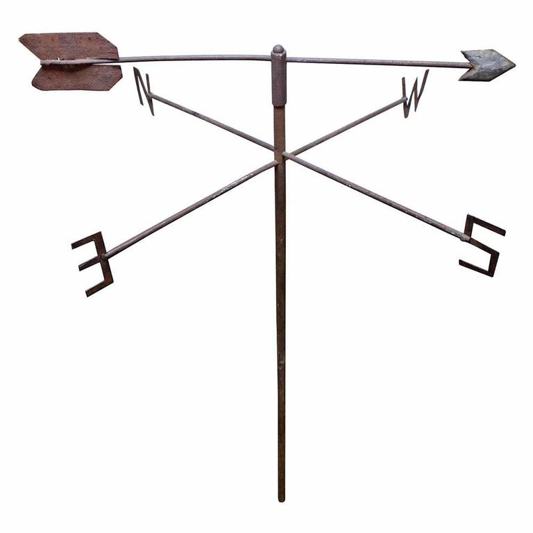 Featuring hand-cut cardinal directions and a hand-hammered arrow, this rusted iron weather vane is an exemplary piece of American Folk Art. Arrow is removable.