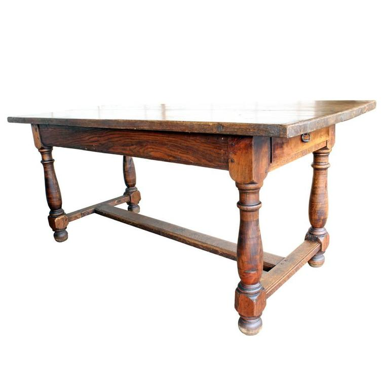A beautiful and substantial solid oak table made in the early 20th century in France. The charming character of the top, which embraces the natural growth patterns of the wood, gives it just the right touch of rusticity. The Classic Silhouette and