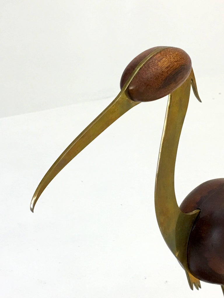 Crane sculpture Bill Scott, USA 1991 Walnut, brass lacquer 17 tall x 15 deep and 7.5 inches wide.  From an estate of a collector of art from around the United States.  Elegant details such as the method used to cut the brass to impart bird feather