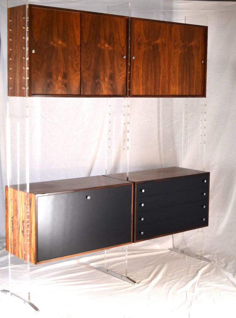 Poul Nørreklit,  Georg Petersens Møbelfabrik, Denmark circa 1969 Acrylic, steel, Brazilian Rosewood, lacquer Measure: 82.5 tall x 16 deep and 68.5 inches wide  A substantial and bold executive upright storage system with optional dividers