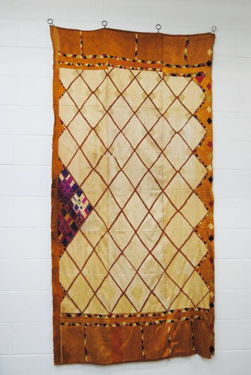 A very rare Chandi Phulkari Bagh wedding shawl from Punjab, India, mid-20th century. Hand loomed cotton khadi cloth is hand embroidered in silk threads by members of the young girl's family for her wedding. Very good condition with minimal wear of