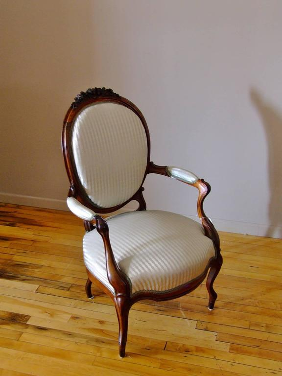 Antique European hand-carved rosewood chair with fine hand-carved details. Chair has been newly upholstered in a Scalamandre silk stripe in soft blue and silver with antique gimp. Wood in very good original condition.