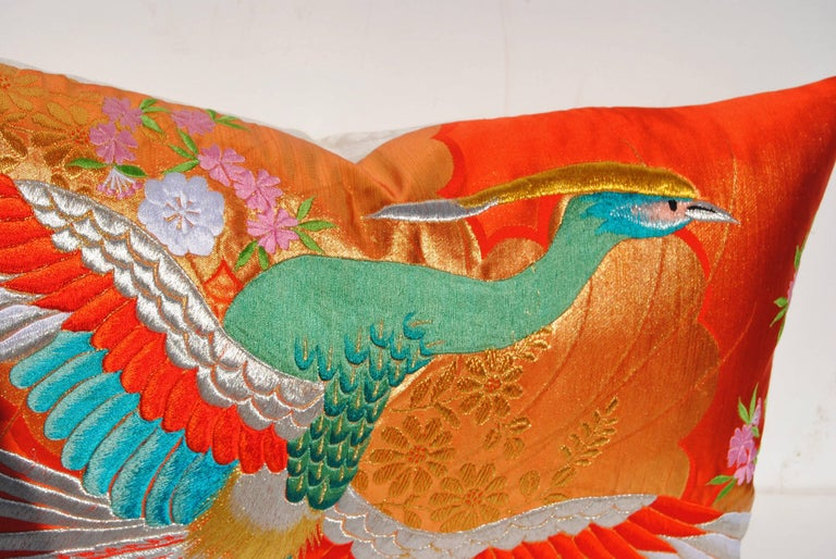 Custom pillow cut from a vintage Japanese silk uchikake, the traditional wedding kimono. The silk is embroidered in vibrant silk and metallic threads in traditional Japanese designs. Pillow is backed in cream linen Scalamandre damask, filled with an