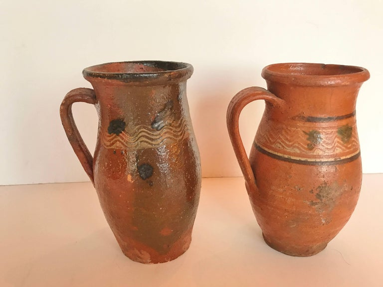 Vintage Transylvania red ware pottery pitchers,  splatter painted glaze.  Romanian terra-cotta, Folk Art.  Early to mid 1900's.  Measurments: One pitcher is 8.25