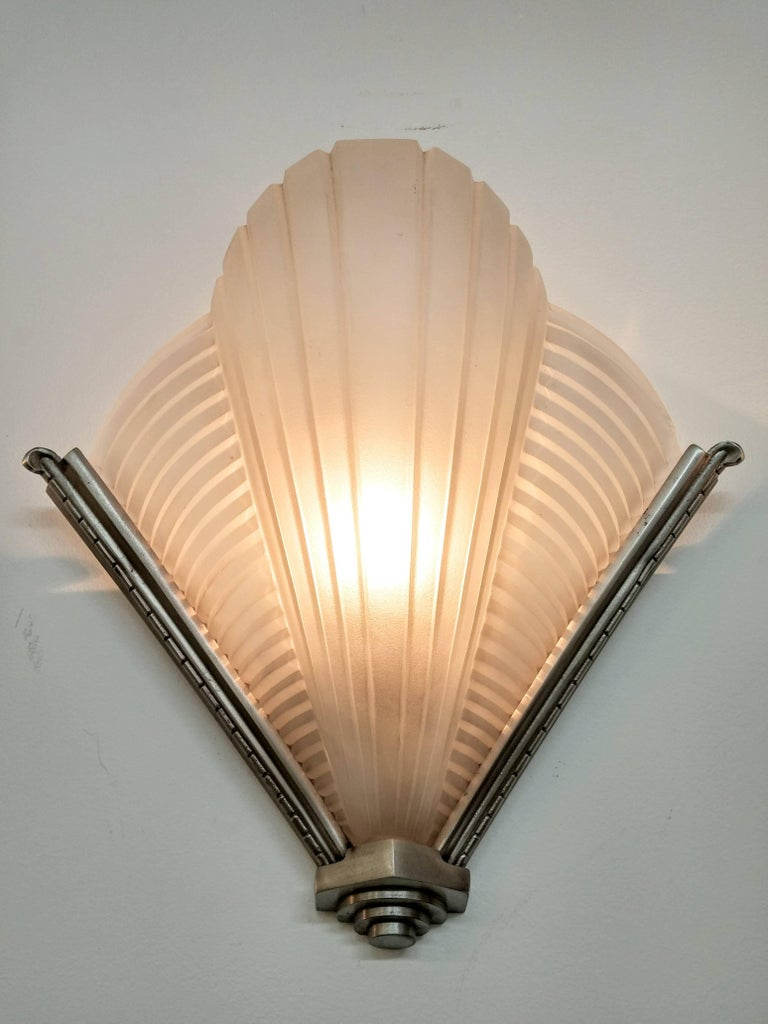 A pair of French Art Deco wall sconces by the French artist