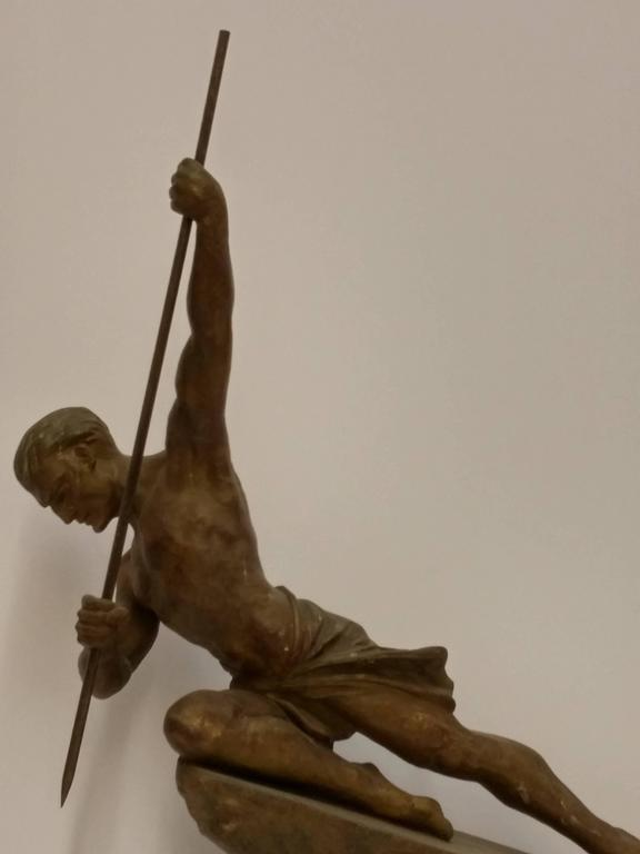 A French Art Deco hunter with a spear sculpture in green golden patina by the French artist R. Varnier. In great condition with modest wear commensurate with age. Will be included with a marble base.