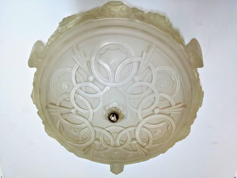 A stunning grand scale French Art Deco flush mount which was created by the French artist