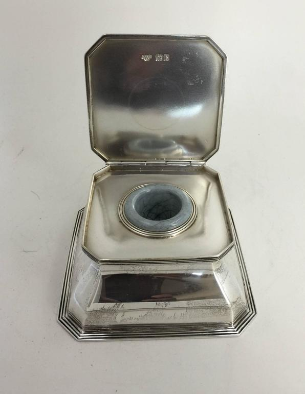 The rectangular inkwell with flat hinged lid, opening to reveal ceramic well and cut-glass liner beneath. Hallmarks on inside cover, rear and underside.