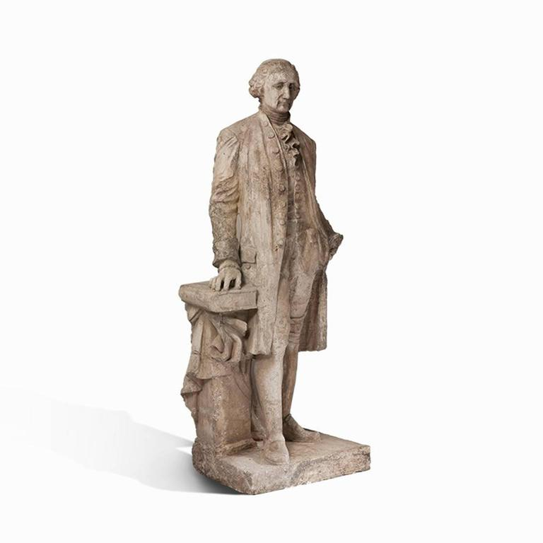 This impressive statue of the first President of the United States, George Washington, is made of French plaster and is in good condition, His gaze is serious, almost stern, and his pose exudes authority and wisdom. This is emphasized by the book to