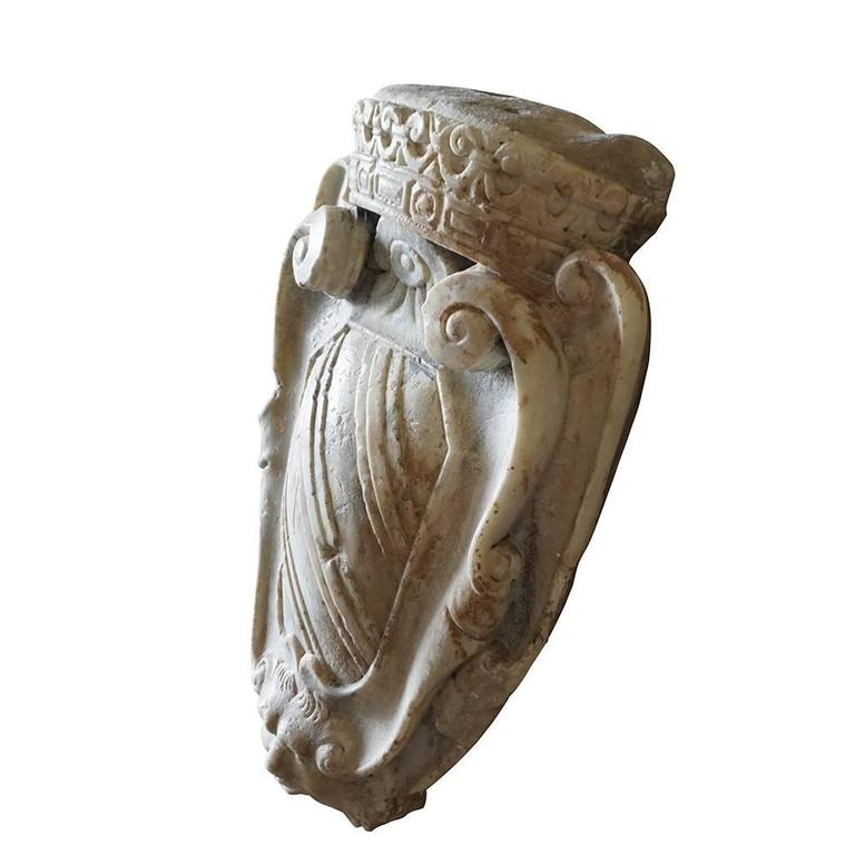 An antique family crest wall mount from an antique Italian palazzo in Parma. Hand carved Carrara marble with a lion, scrolls and topped with a crown, in good condition. Wear consistent with age and use, circa 1780, Parma, Italy.