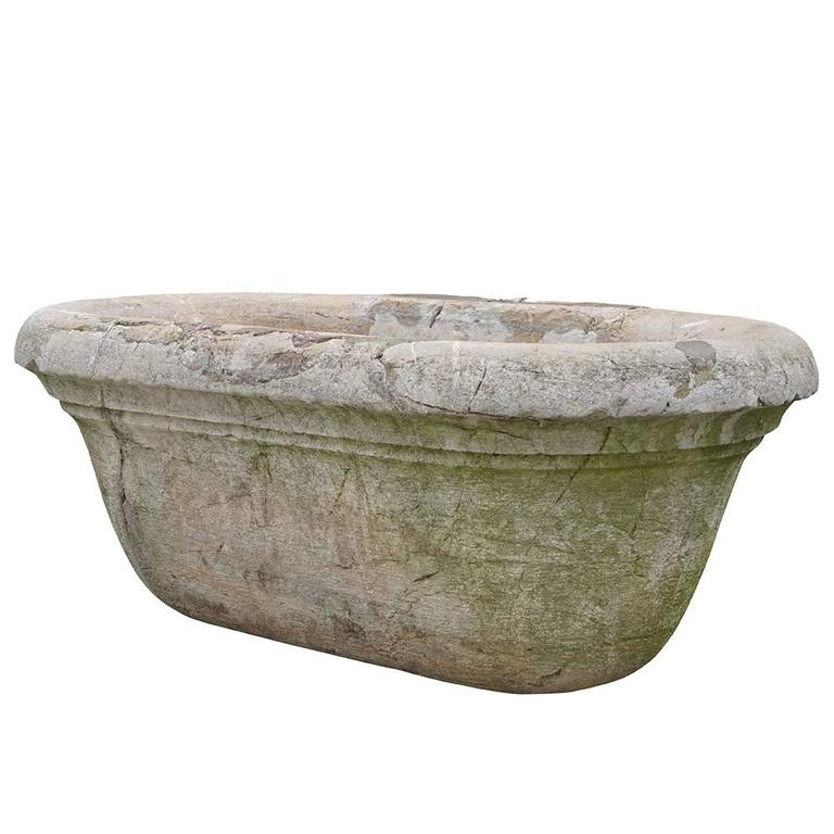 Hand carved antique Italian marble tub made of Biancone marble. The tub has a small steed with an over dimensional rim. Wear consistent with age and use, circa 1820-1860 Trieste, Italy.