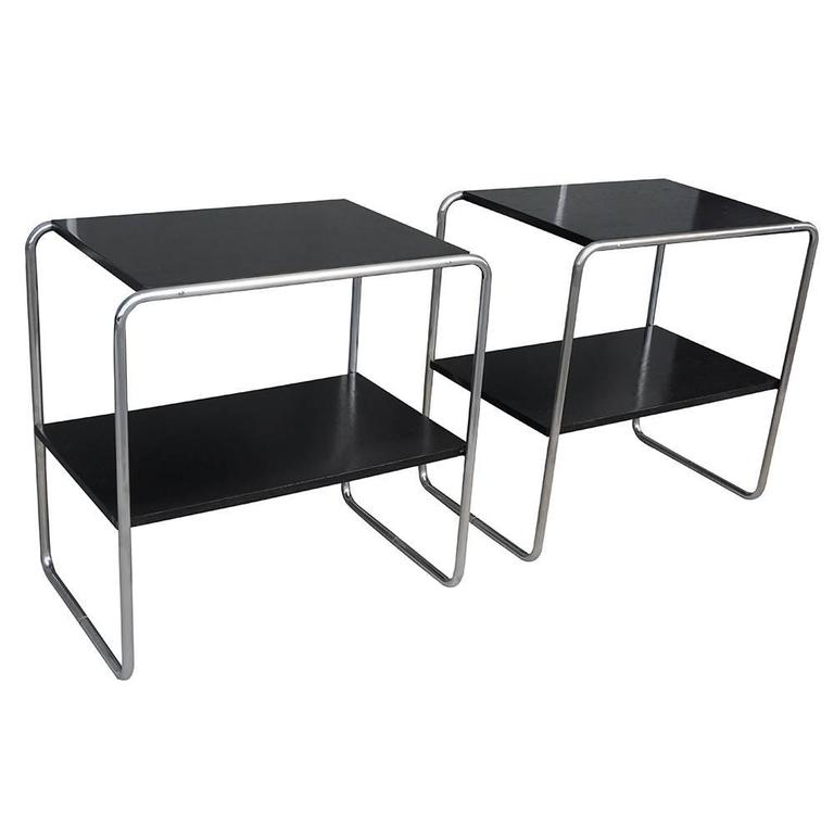 A vintage Art Deco Austrian pair of bar console tables made of handcrafted black lacquered Plywood and chrome steel. Designed Marcel Breuer, in good condition. The end tables are representing the Bauhaus period. Wear consistent with age and use,