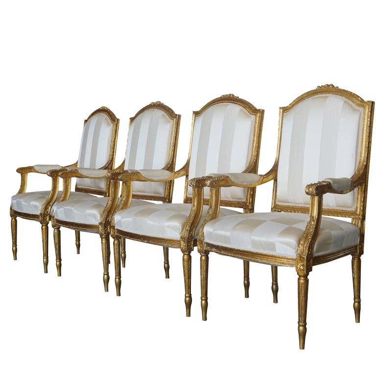 A set of four very detailed carved and gilded armchairs from the 19th Century in good condition, circa 1860 France.