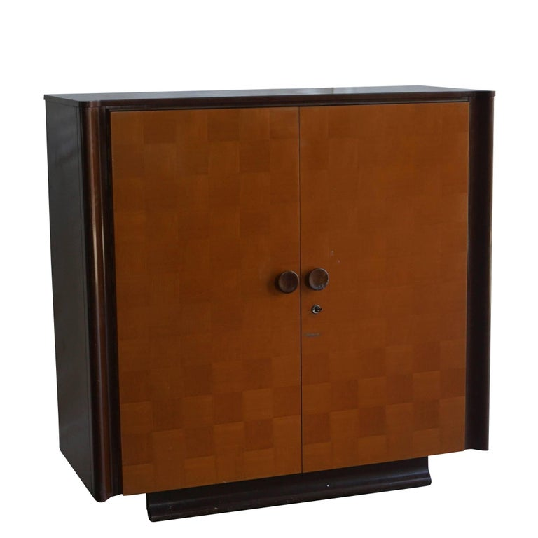A vintage Art Deco Czech sideboard made of mahogany and pinewood with interior shelves standing on scrolled feet with rounded corners, very detailed diamond shaped inlays, black lacquered sides and top, and contains original hardware, in good