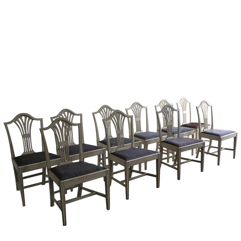 A very rare set of ten comfortable Swedish, Gustavian Style dining chairs in good condition. The chairs are finished in a typical grey paint, arched backs, graceful openwork, fluted legs joined by H-shaped stretchers, circa 1880-1910 Sweden,