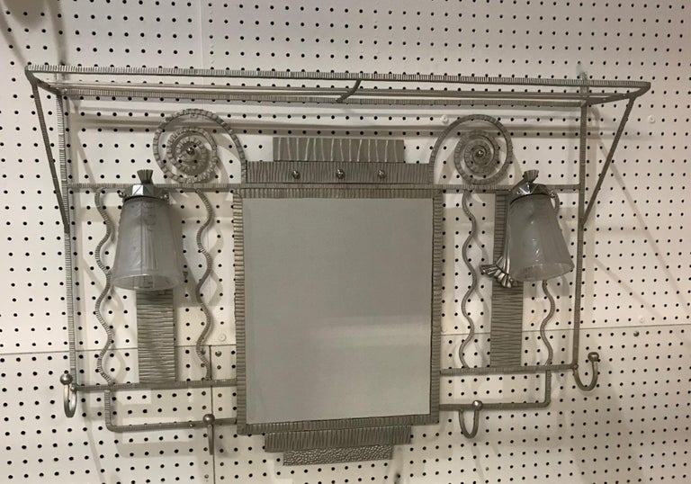 French Art Deco coat rack with pair signed of Muller Frères Luneville sconces. With two clear frosted glass shades having geometric motifs. Held by a polished nickel design frame. Features a central beveled mirror and hat rack with beautiful Deco