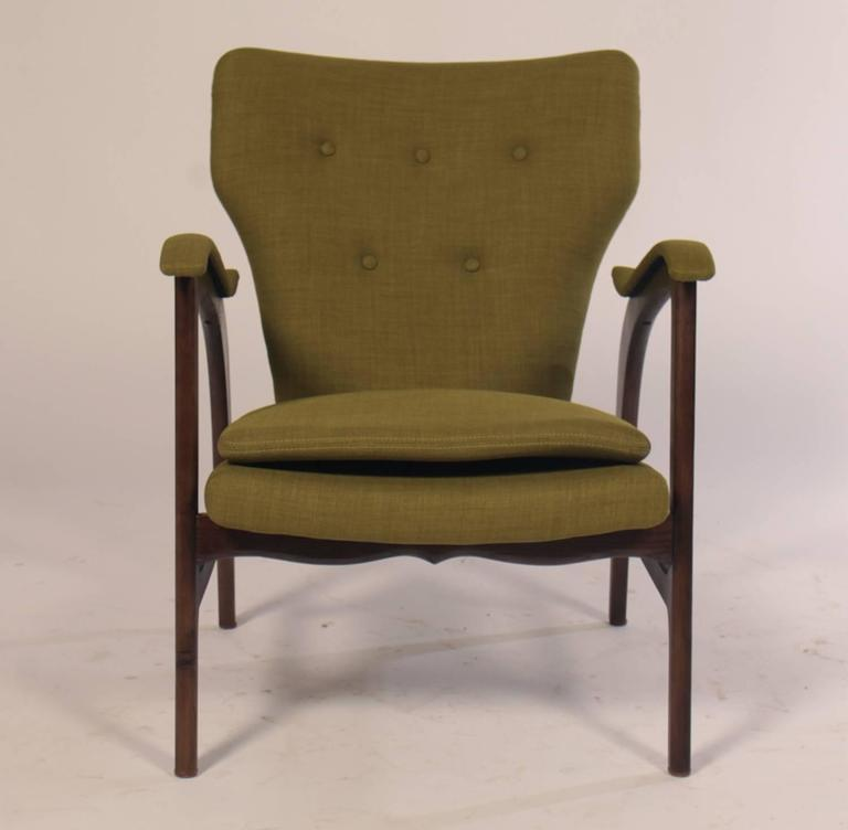 A pair of Mid-Century Modern  club chairs / armchairs with green upholstered fabric.