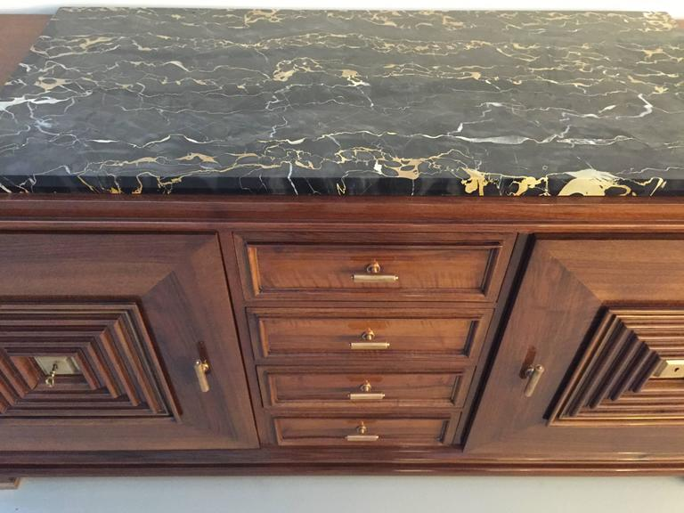 French Art Deco in the style of Maxime old mahogany marble top buffet. Four central draws flanked by cabinet doors covered with very detailed designed door panels. This buffet is remarkable, with stunning bronze detailing. The beauty and