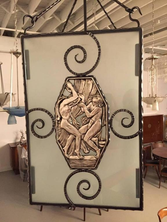 Stunning French Art Deco nickel over bronze and iron lantern. The frame having figural bronze panels depicting mythical scenes. Height can be adjusted upon request.