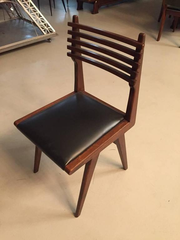 Set of six Italian Mid-Century Modern dining chairs. Have not been refinished, in original condition.