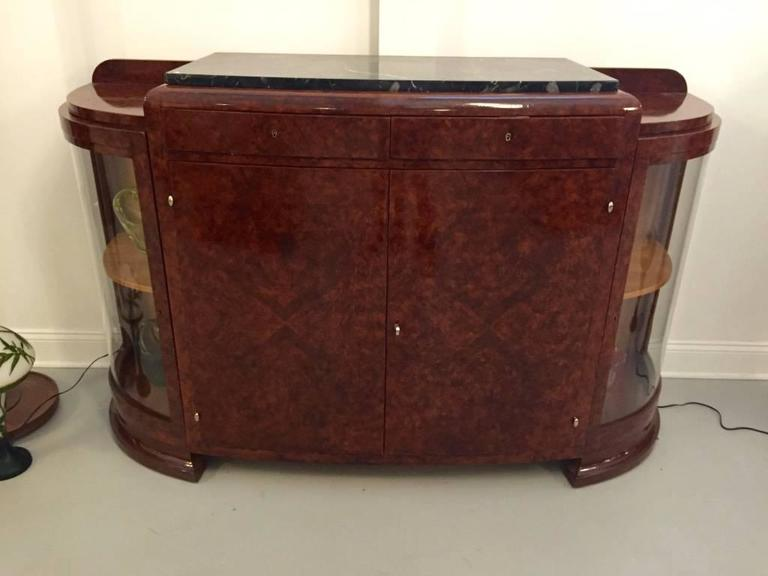 Stunning French Art Deco burl Amboyna buffet with Portoro marble top. Having two central doors flanked by glass doors. Plenty of space for storage and display. With beautiful deco legs and details.