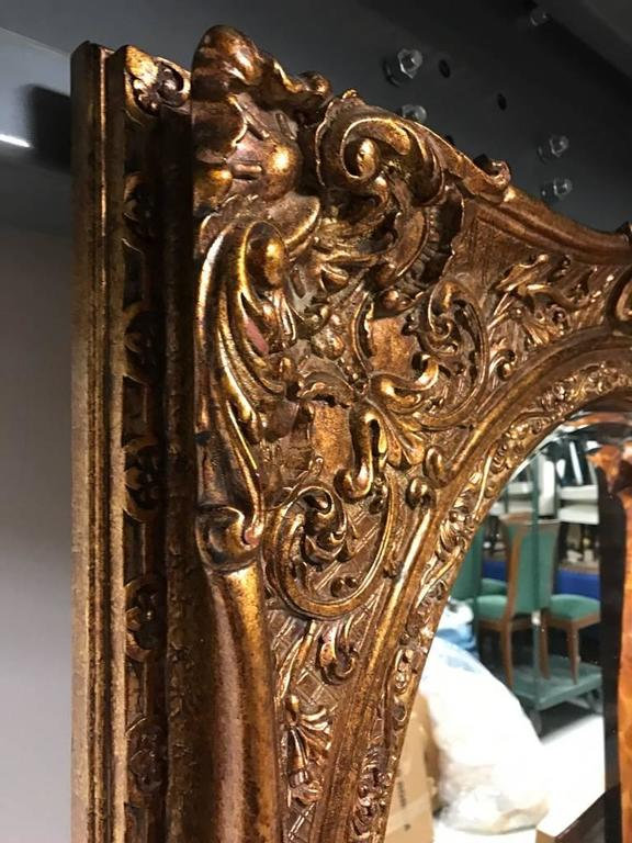 20th Century Giltwood Mirror with Ornate Details For Sale