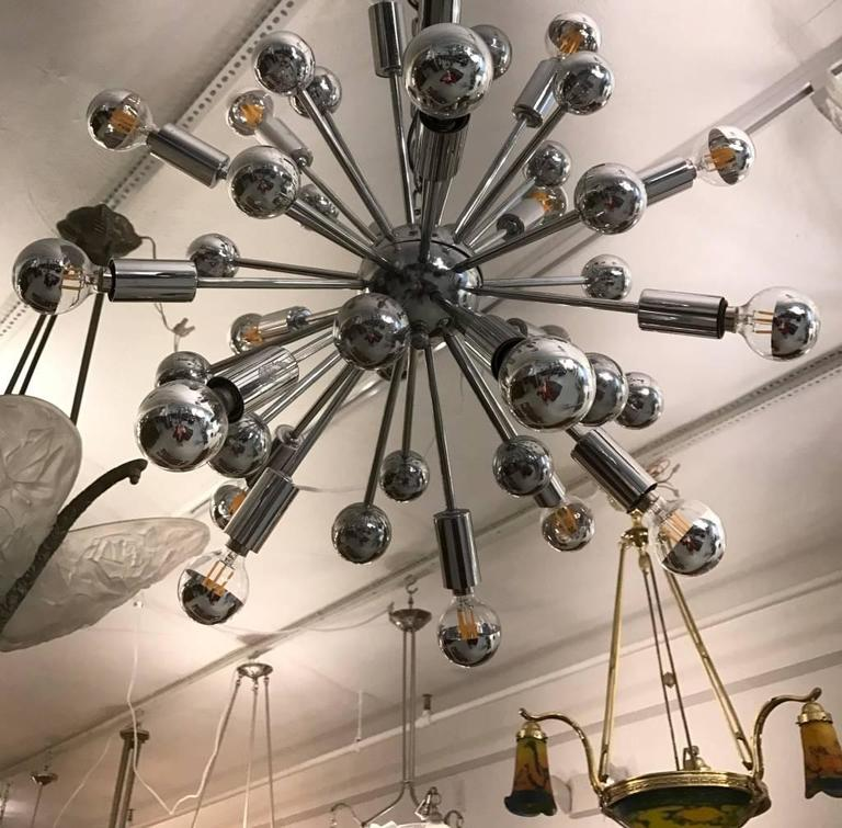 Mid Century Modern chrome Sputnik chandelier. Any amount of chain can be added for custom hanging length.   Height without chain 18 inches .