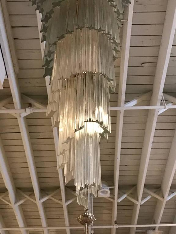 Stunning Mid-Century Modern Italian spiral chandelier. Each of the prisms are solid glass. They hang from hooks onto a spiral brass frame, as pictured. Any amount of chain can be added for custom hanging length of the chandelier.   Measures: Height