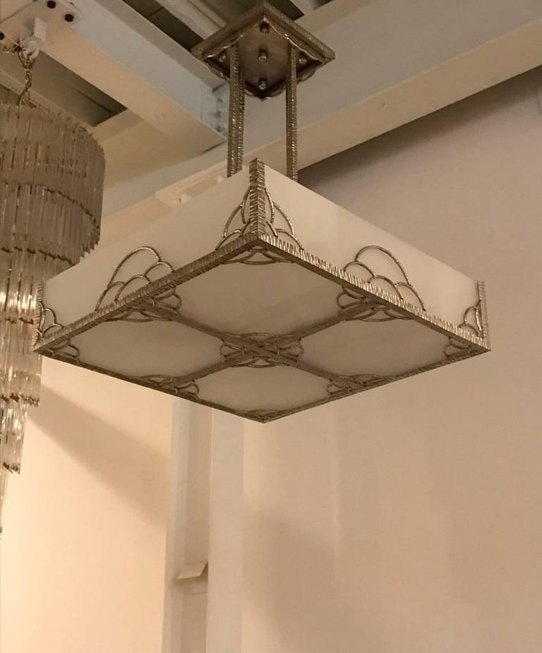 Early 20th Century French Art Deco Industrial Nickeled Iron and Glass Chandelier For Sale